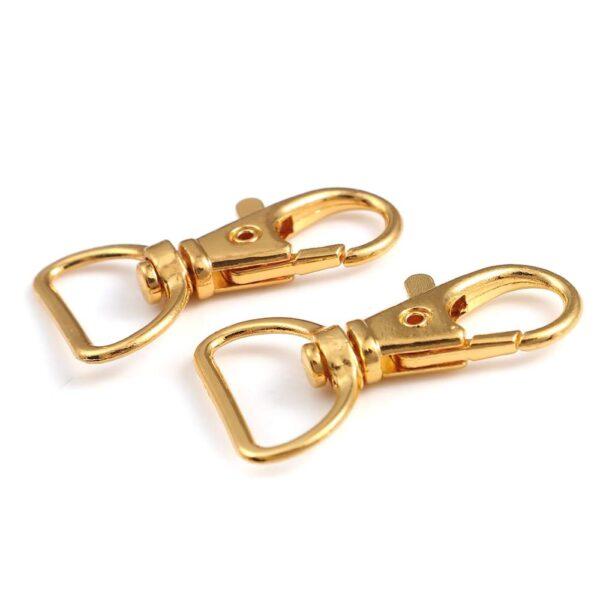 זוג אבזמים לתיקים/מחזיקי מפתחות צבע זהב